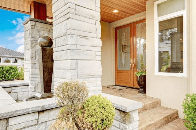 STONE PORCH COLUMNS AND FLOORING