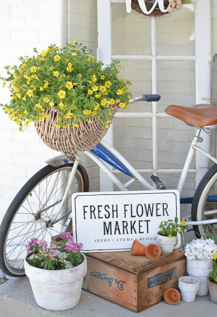 FARMHOUSE PORCH DECOR IDEAS WITH FLOWER AND OLD BICYCLE