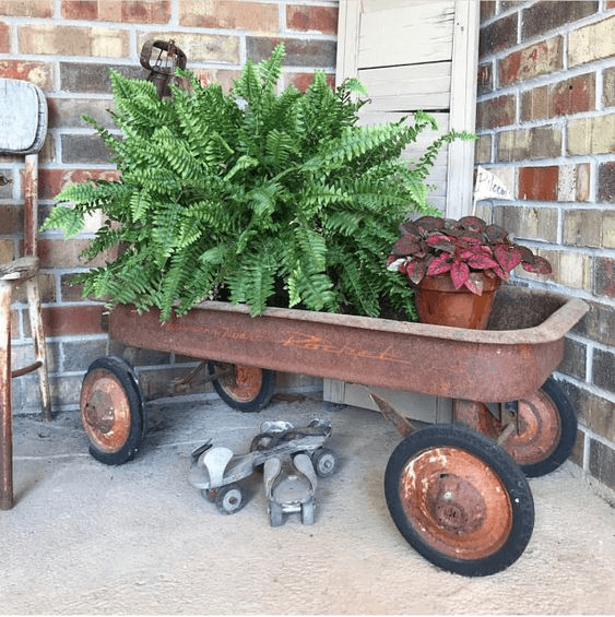 FARMHOUSE PORCH DECOR IDEAS WITH RUSTY WAGON POTTED PLANTS AND FLOWERS