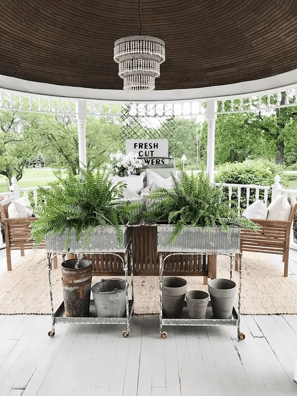 FARMHOUSE PORCH DECOR IDEAS WITH RUSTY WHEELED CART AND OLD BUCKETS