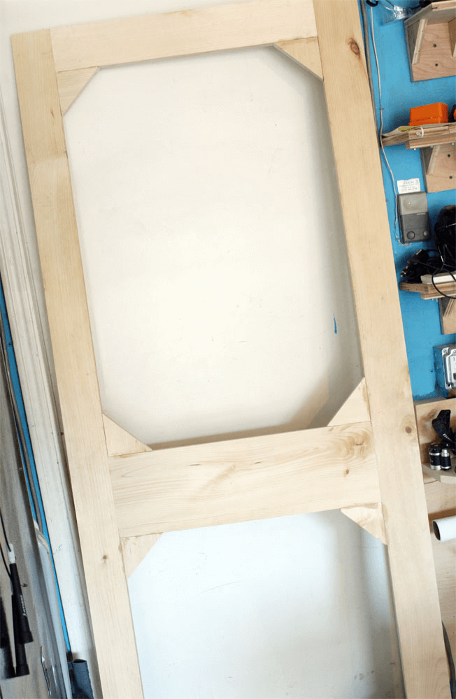 WOODEN FRAME WITH TRIANGLE INSERT TO BUILD SCREEN DOOR PORCH