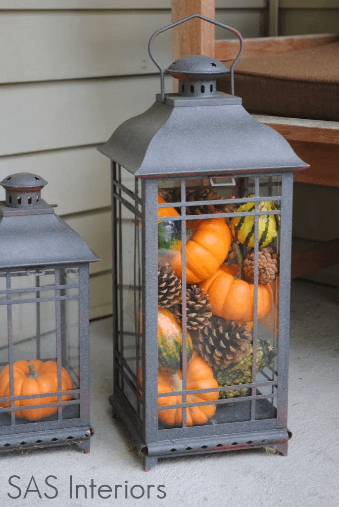 DIY PORCH DECOR IDEAS ON A BUDGET FOR FALL AND WINTER WITH LANTERNS FILLED MINI PUMPKINS