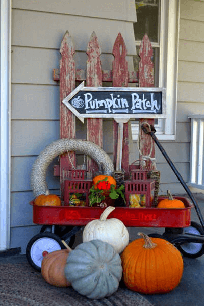 DIY PORCH DECOR IDEAS WINTER AND FALL WITH OLD FENCE, RED WAGON, AND PATCH SIGN