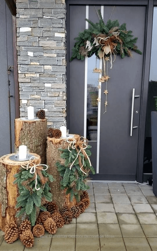 DIY PORCH DECORATION IDEAS FOR WINTER AND FALL WITH WOODEN LOGS WITH PINECONES AND CANDLES
