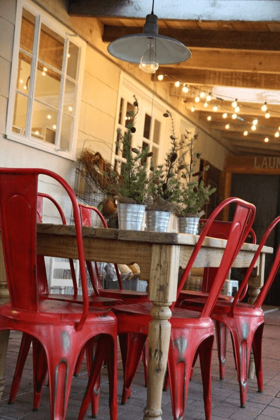 RED CHAIRS AND PLANTS IN TIN BUCKETS FOR PORCH DECOR PARTY