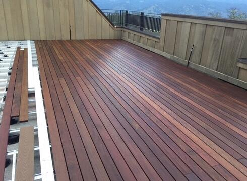 PORCH WITH A HARDWOOD ROOFTOP DECK