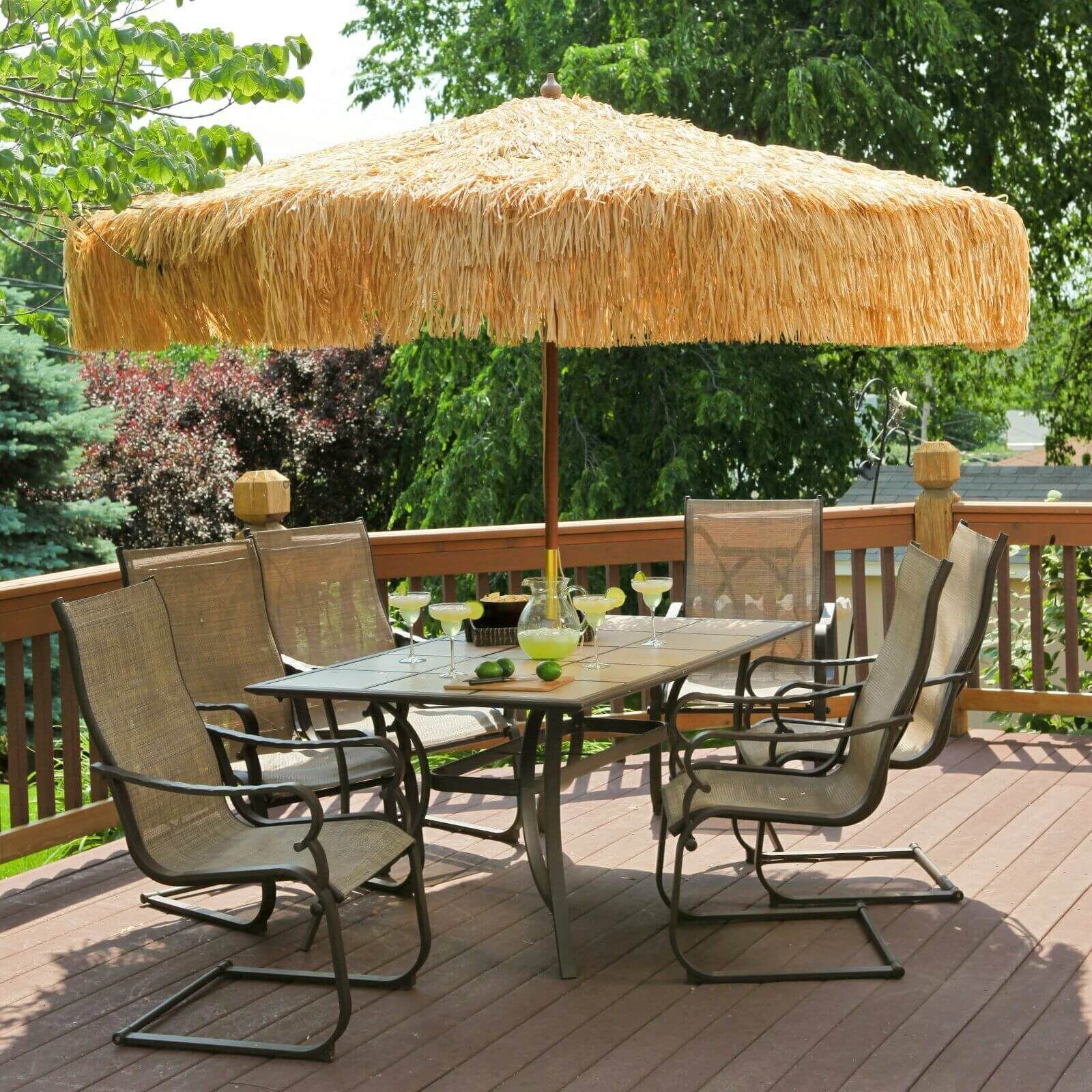 PATIO SET DESIGN IDEAS WITH UMBRELLA AND TROPICAL ATMOSPHERE