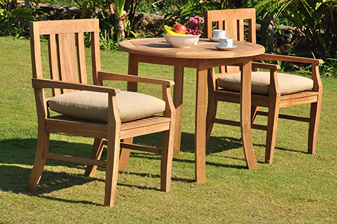 A SET FOR TWO ROUND PATIO TABLE AND CHAIRS